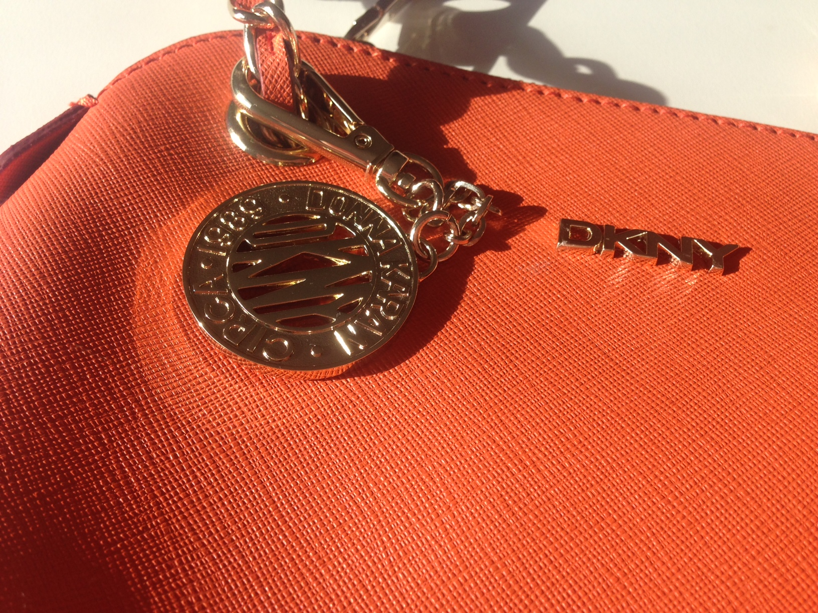 Bryant orange saffiano cross-body bag